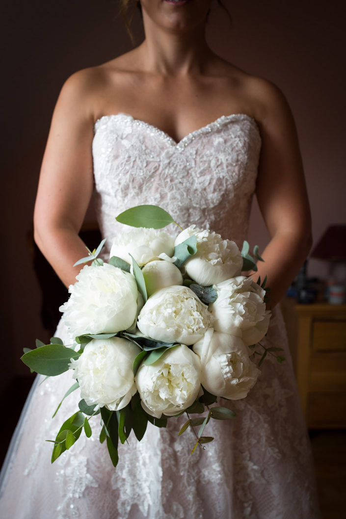 white peonie roses in wedding bouquet