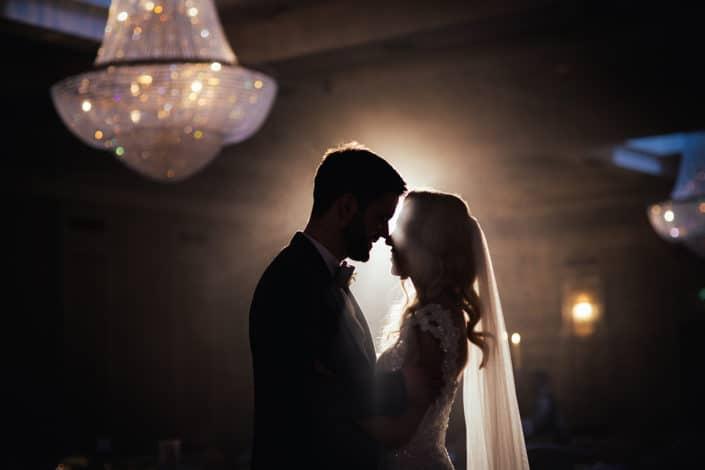 dramatic wedding portrait of newly weds