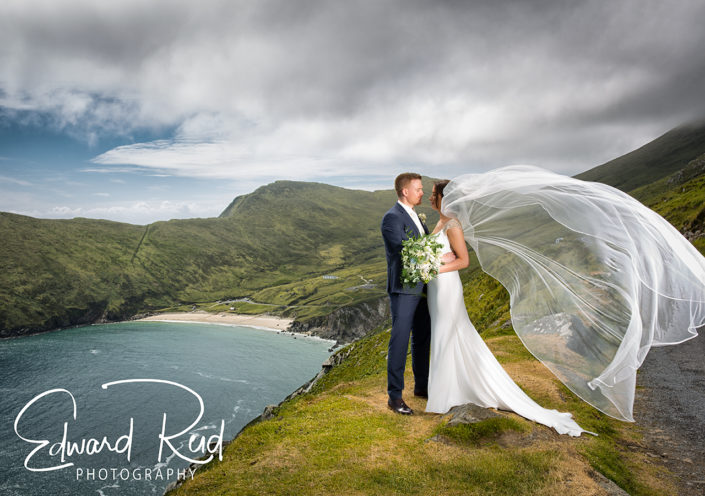 bride and groom overlooking keem beach on achill island