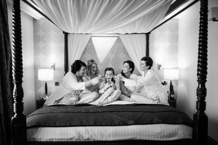 bridesmaids toast on four poster bed at castlecourt hotel