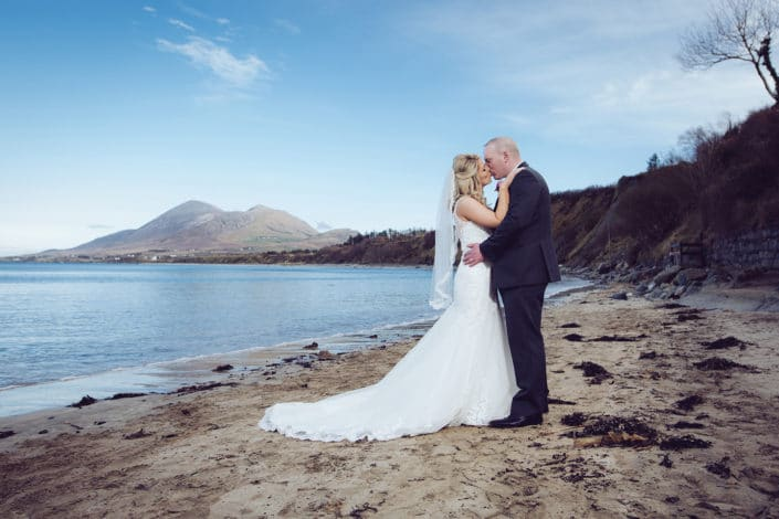 bride and groom on beach location near westport mayo