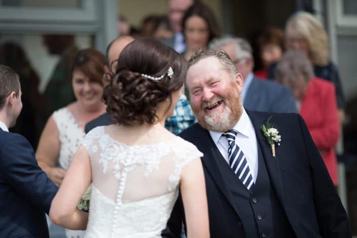 brides dad smile and congratulations outside mayo abbey church